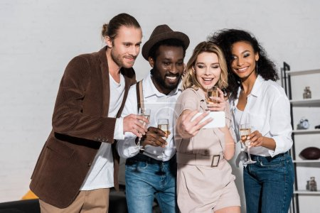 Photo for Attractive girl taking selfie with multicultural friends holding champagne glasses - Royalty Free Image