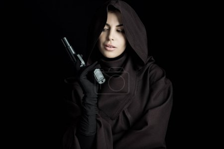 Photo for Beautiful woman in death costume holding gun isolated on black - Royalty Free Image