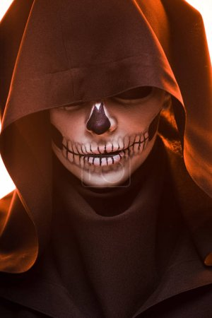 Woman with skull makeup in black death costume...