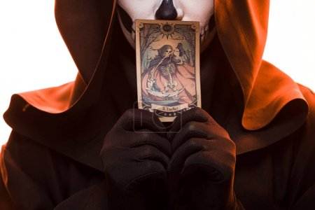 Foto de KYIV, UKRAINE - APRIL 18, 2019: cropped view of woman with skull makeup holding tarot card isolated on white - Imagen libre de derechos
