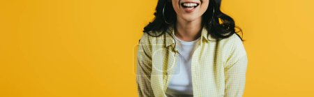 cropped view of smiling brunette girl isolated on yellow