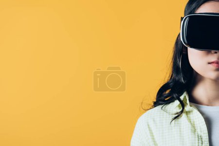 cropped view of girl in Virtual reality headset, isolated on yellow