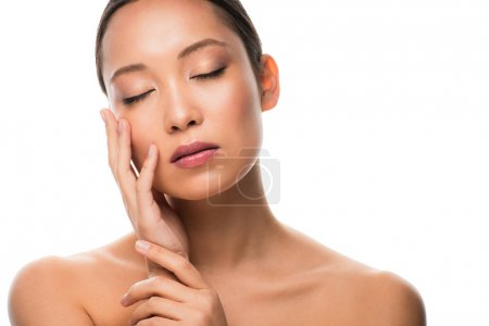 Foto de Tender naked asian woman with closed eyes, isolated on white - Imagen libre de derechos