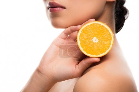 cropped view of woman holding orange, isolated on white