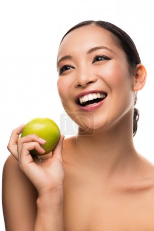 Photo for Attractive asian girl laughing and holding green apple, isolated on white - Royalty Free Image