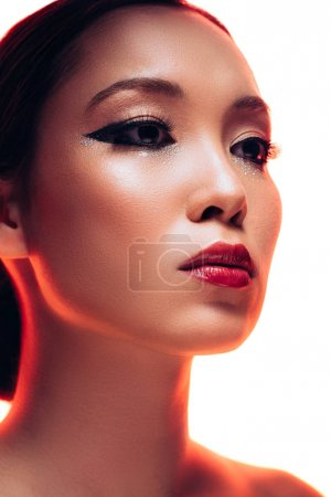 Photo for Perfect asian woman with makeup in red light, isolated on white - Royalty Free Image