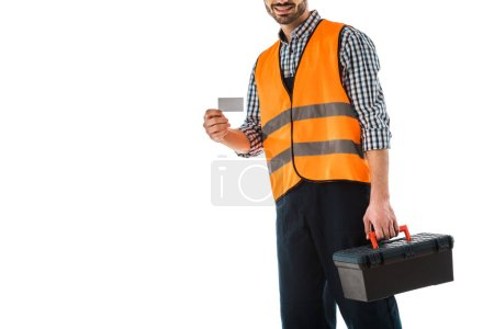 Photo for Cropped view of construction man in safety vest holding blank business card isolated on white - Royalty Free Image