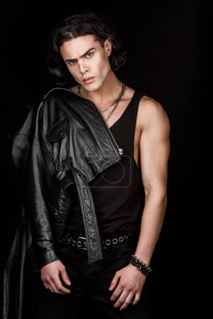 Photo for Handsome and serious man in leather jacket looking at camera isolated on black - Royalty Free Image