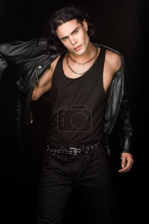 Photo for Handsome man wearing leather jacket and looking at camera isolated on black - Royalty Free Image