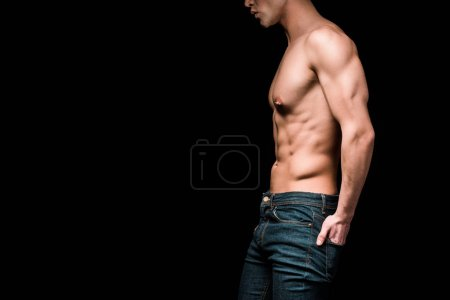 Photo for Cropped view of muscular and shirtless man standing with hand in pocket isolated on black - Royalty Free Image