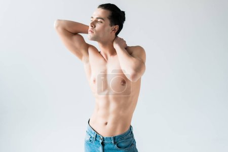 Photo for Handsome and muscular man posing while standing on white - Royalty Free Image