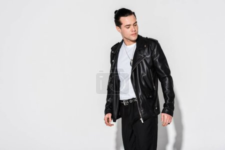 Photo for Trendy man in leather jacket standing on white - Royalty Free Image