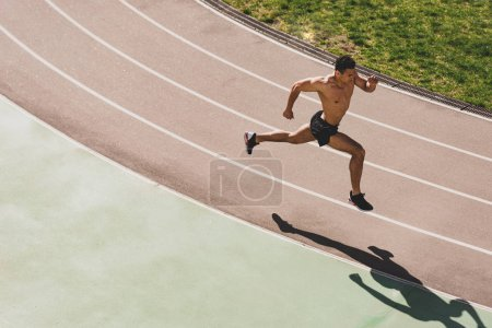 overhead view of mixed race sportsman running at stadium