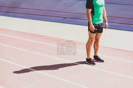 Photo for Cropped view of sportsman in sportswear standing at stadium - Royalty Free Image