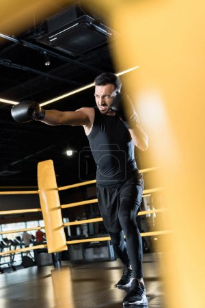 Photo for Selective focus of strong bearded man boxing in sports center - Royalty Free Image