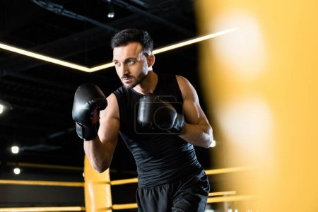 Photo for Selective focus of bearded and strong man boxing in gym - Royalty Free Image