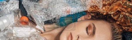 Photo for Panoramic shot of woman with closed eyes among waste in bathtub - Royalty Free Image