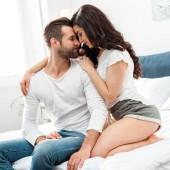 """Постер, картина, фотообои """"boyfriend and girlfriend gently embracing in bed """""""
