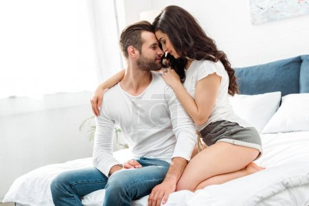 Photo for Boyfriend and girlfriend gently embracing in bed at morning - Royalty Free Image