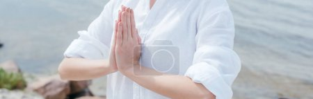 Photo pour Panoramic shot of young woman with praying hands - image libre de droit
