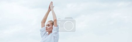 Photo pour Panoramic shot of attractive girl with closed eyes practicing yoga and standing with praying hands - image libre de droit