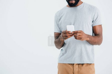 Photo for Cropped view of african american man using smartphone, isolated on grey - Royalty Free Image