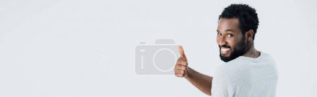 Photo for Cheerful african american man in grey t-shirt showing thumb up isolated on grey - Royalty Free Image
