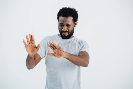 Photo for Worried african american man in grey t-shirt gesturing isolated on grey - Royalty Free Image