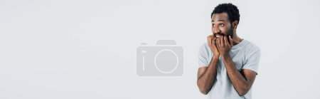 Photo for Stressed african american man in grey t-shirt, isolated on grey - Royalty Free Image