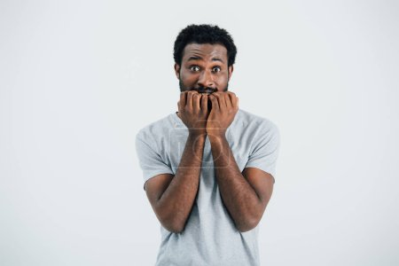Photo for Worried african american man in grey t-shirt, isolated on grey - Royalty Free Image