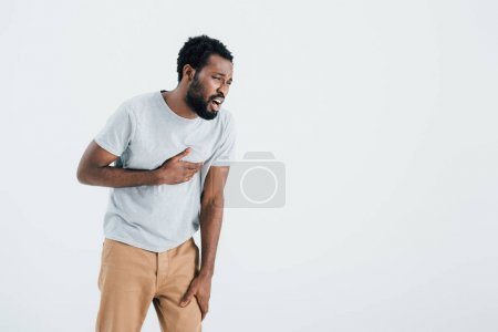 handsome african american man having heart attack isolated on grey