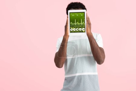Photo for African american man showing digital tablet with health app, isolated on pink - Royalty Free Image