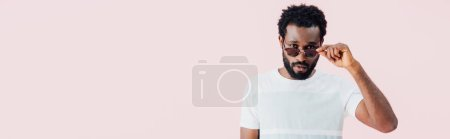Photo for Handsome african american of man in sunglasses isolated on pink - Royalty Free Image