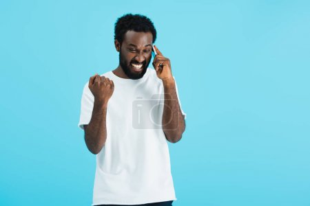 Photo pour Excited african american man talking on smartphone, isolated on blue - image libre de droit