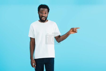 Photo for Excited african american man pointing isolated on blue - Royalty Free Image