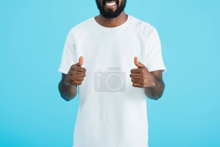 cropped view of african american man showing thumbs up isolated on blue