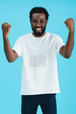 Photo for Excited handsome african american man gesturing isolated on blue - Royalty Free Image