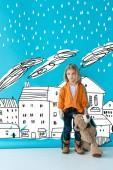 "Постер, картина, фотообои ""upset and adorable kid holding teddy bear on blue background with rain over buildings illustration"""