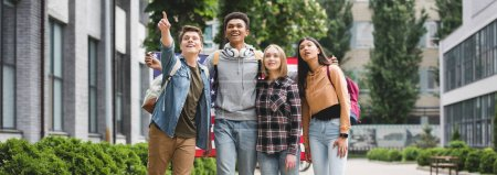 Photo for Panoramic shot of teenagers holding american flag and pointing with finger - Royalty Free Image