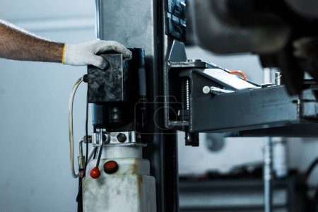 Photo for Cropped view of auto mechanic in car repair station - Royalty Free Image