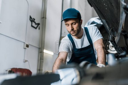Photo for Selective focus of handsome car mechanic fixing car - Royalty Free Image