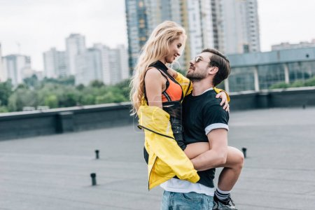 Photo for Attractive and blonde woman hugging with handsome man in glasses - Royalty Free Image