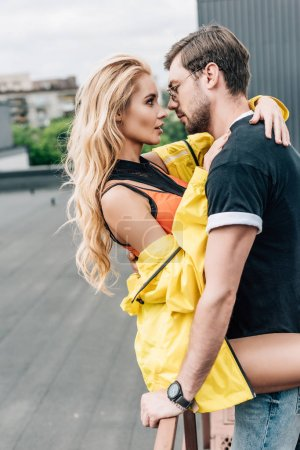 Photo for Blonde woman and handsome man hugging and looking at each other - Royalty Free Image