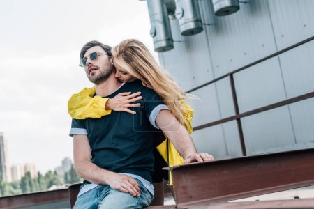 Photo for Beautiful and blonde woman kissing and hugging handsome man - Royalty Free Image