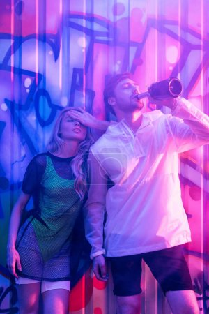 Photo for Attractive and blonde woman with closed eyes and handsome man drinking champagne - Royalty Free Image