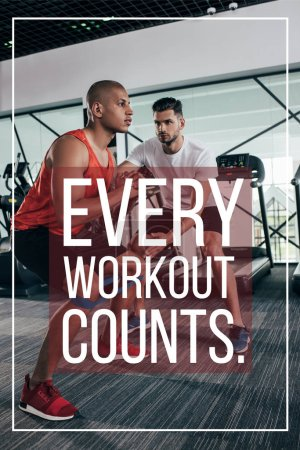 Photo for Attentive trainer supporting african american sportsman near illustration with every workout counts inscription - Royalty Free Image