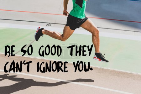 Photo for Cropped view of sportsman in black sneakers running at stadium with be so good they cant ignore you lettering - Royalty Free Image