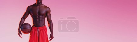Photo for Cropped view of shirtless african american basketball player holding ball on light purple background with gradient, panoramic shot - Royalty Free Image