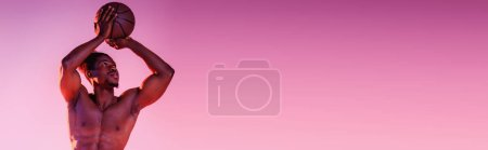 Photo for Panoramic shot of shirtless, muscular african american sportsman playing basketball on pink and purple gradient background - Royalty Free Image