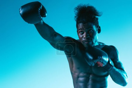 Photo for Shirtless african american sportsman with muscular torso on blue background - Royalty Free Image